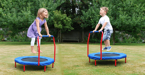 children having fun on their mini trampolines