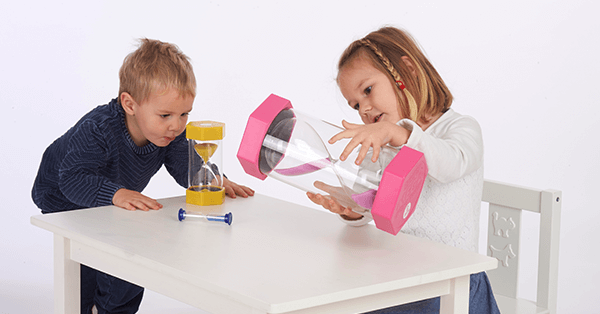 children discovering time with their hands, with colourful sandtimers